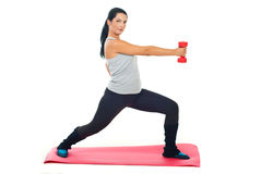 Woman exercising with red barbell Royalty Free Stock Image