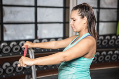 Woman exercising with resistance band Stock Photo