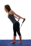 Woman Exercising With Resistance Rope Royalty Free Stock Photos