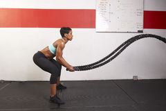 Woman Exercising With Ropes Royalty Free Stock Photo