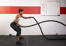 Woman Exercising With Ropes Royalty Free Stock Image