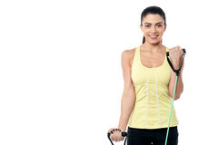 Woman exercising with rubber band Royalty Free Stock Photos