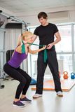 Woman exercising  with rubber bands Royalty Free Stock Images