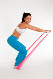 Woman exercising with rubber ribbon Royalty Free Stock Photo