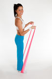 Woman exercising with rubber ribbon Stock Photo