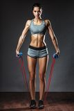 Woman exercising with rubber tape Royalty Free Stock Photo