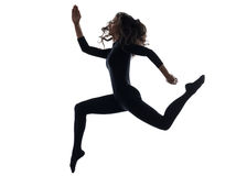 Woman exercising running jumping silhouette Stock Photography