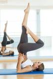 Woman exercising. Stock Photos