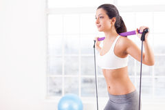 Woman exercising. Stock Photos