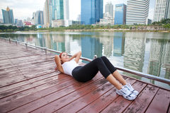 Woman exercising sit ups outside Royalty Free Stock Photo