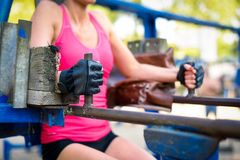 Woman exercising on sport equipment. Cropped shot of woman in sportswear exercising on sport equipment Royalty Free Stock Photo