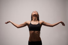 Woman exercising in sports Stock Photography