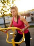 Woman exercising on a stationary bike. Stock Photography