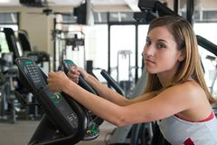 Woman Exercising On Stationary Cycle Stock Image