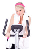 Woman exercising on stationary training bicycle Stock Photos