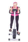 Woman exercising on stationary training bicycle Royalty Free Stock Photos
