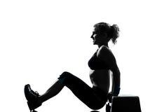 Woman exercising step aerobics Royalty Free Stock Photography