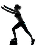 Woman exercising step aerobics Stock Photos