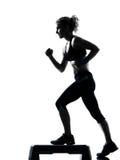 Woman exercising step aerobics Stock Photo