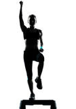 Woman exercising step aerobics Royalty Free Stock Image