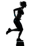 Woman exercising step aerobics Stock Photo