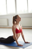Woman exercising sun salutation cobra pose yoga Stock Photos
