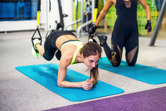 Woman exercising with suspension straps in fitness Royalty Free Stock Photos