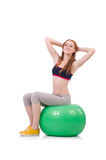 Woman exercising with swiss ball Royalty Free Stock Photos