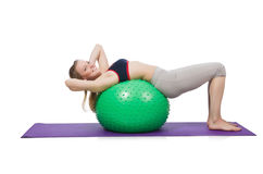 Woman exercising with swiss ball Royalty Free Stock Photography