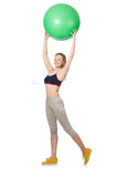 Woman exercising with swiss ball Stock Images
