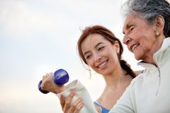 Woman exercising with trainer Royalty Free Stock Image