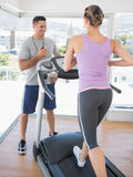 Woman exercising on treadmill Royalty Free Stock Photos