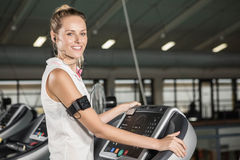 Woman exercising on a treadmill Stock Photography
