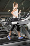 Woman exercising on a treadmill Royalty Free Stock Image