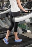 Woman exercising on a treadmill Royalty Free Stock Photos