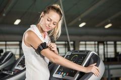 Woman exercising on a treadmill Stock Photo
