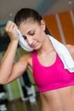Woman exercising on treadmill in gym Stock Photography