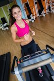 Woman exercising on treadmill in gym Royalty Free Stock Images