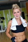 Woman exercising on treadmill in gym Stock Photos