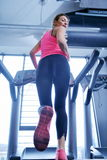 Woman exercising on treadmill in gym Stock Photo