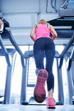 Woman exercising on treadmill in gym Royalty Free Stock Photo