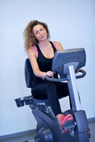 Woman exercising on treadmill in gym Royalty Free Stock Photography