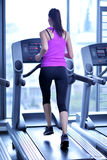 Woman exercising on treadmill in gym Royalty Free Stock Image