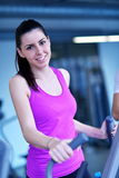 Woman exercising on treadmill in gym Royalty Free Stock Photos