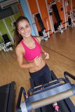 Woman exercising on treadmill in gym Stock Image