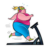 Woman exercising on treadmill Royalty Free Stock Images