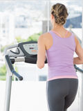 Woman exercising on treadmill Stock Image