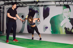 Woman exercising TRX Royalty Free Stock Photography