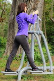 Woman exercising upper and lower body on outdoor gym, healthy lifestyle Royalty Free Stock Photography
