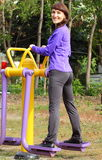 Woman exercising upper and lower body on outdoor gym, healthy lifestyle Royalty Free Stock Photos